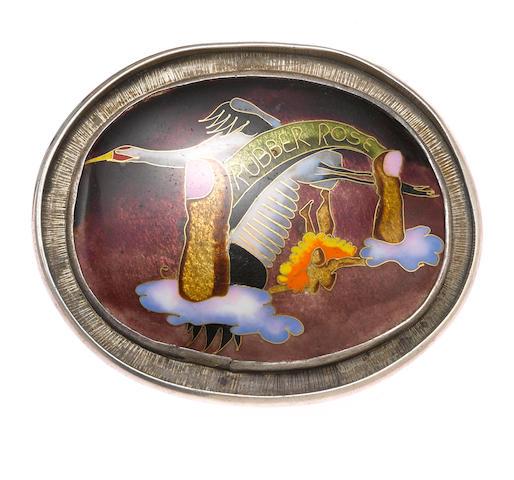 An enamel belt buckle in silver by Colette