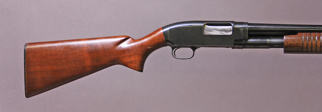 A 12 gauge Winchester Model 12 slide action shotgun
