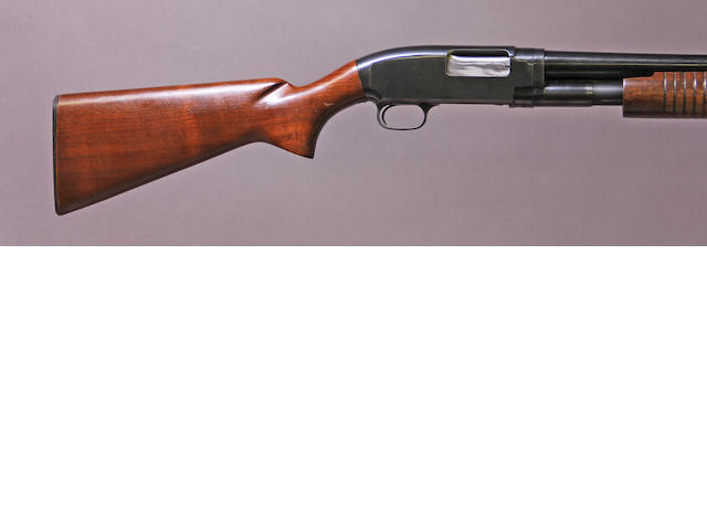 A 12 gauqe Winchester Model 12 slide action shotgun