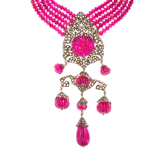 A red stone and diamond necklace