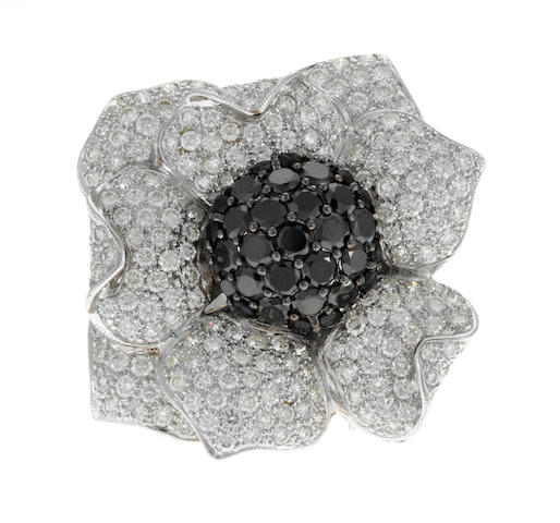 A diamond and black diamond flower ring