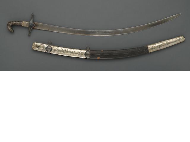 A silver-mounted Arabian shamshir