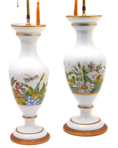 A pair of Continental hand painted porcelain vases, now as lamps
