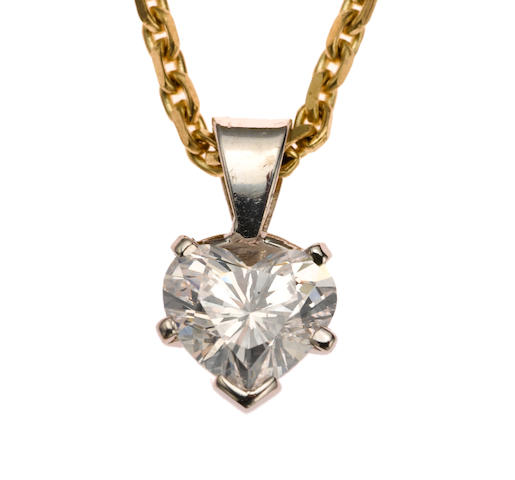 A diamond solitaire pendant with nine karat gold chain