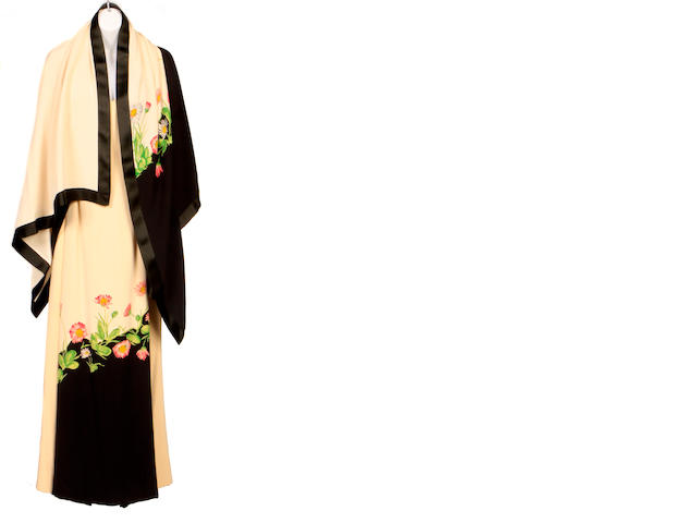 A Galanos eggshell and black gown with shawl