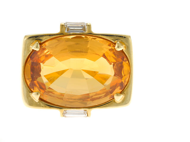A topaz, baguette diamond and 18 karat gold ring