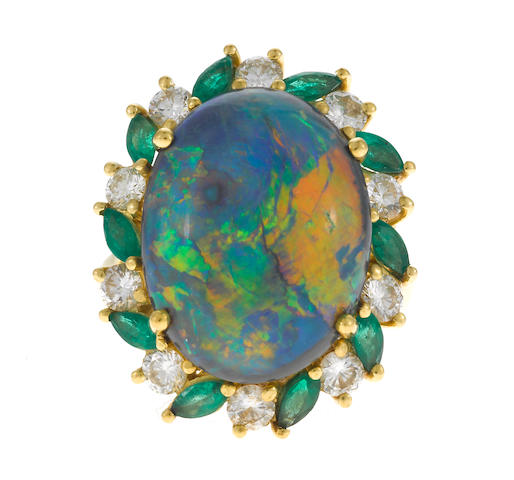 An opal, emerald and diamond ring in 18k gold