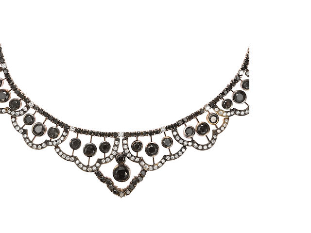 A black and white diamond necklace, 18k