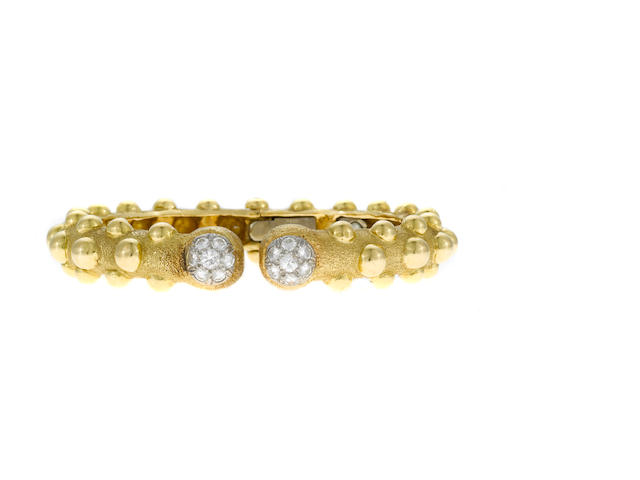 An 18k gold, diamond and platinum bangle bracelet, David Webb