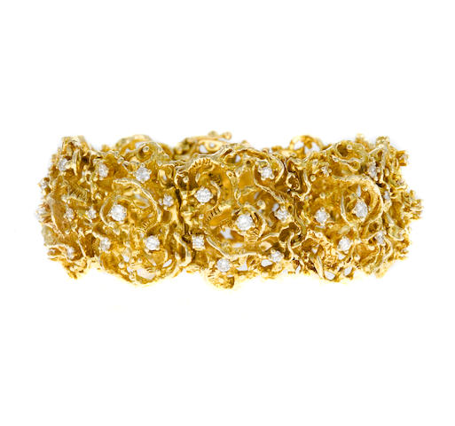A diamond and fourteen karat gold openwork bracelet