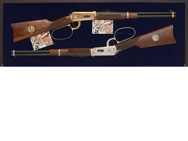 A cased 1 of 300 Set of Winchester John Wayne commemorative 94 carbines
