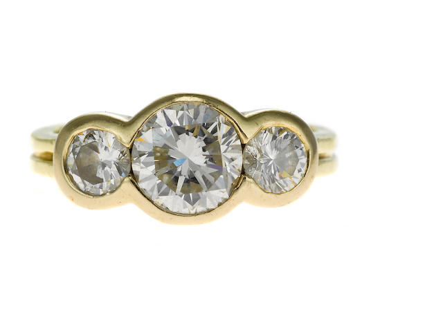 3 stone diamond ring, center stone approx. 1.43 cts, off color