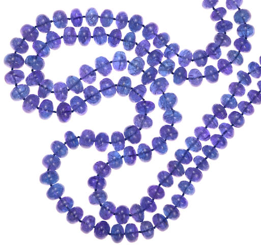 A tanzanite bead and diamond two strand necklace