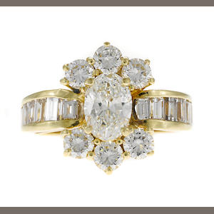 An oval diamond ring with baguette and round diamonds