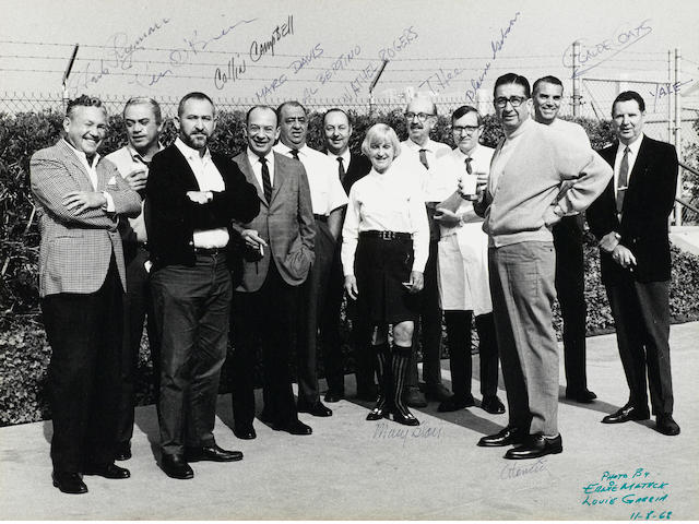 A signed black and white photograph of Disney employees