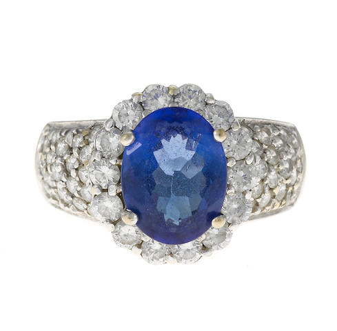 A tanzanite 3.01ct and diamond 1.33ct ring in 18k, 9.1g
