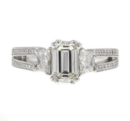 An emerald cut diamond and diamond ring, 1.22ct + .53ct tw 2 sides, 18k, IGI cert, 5.5g