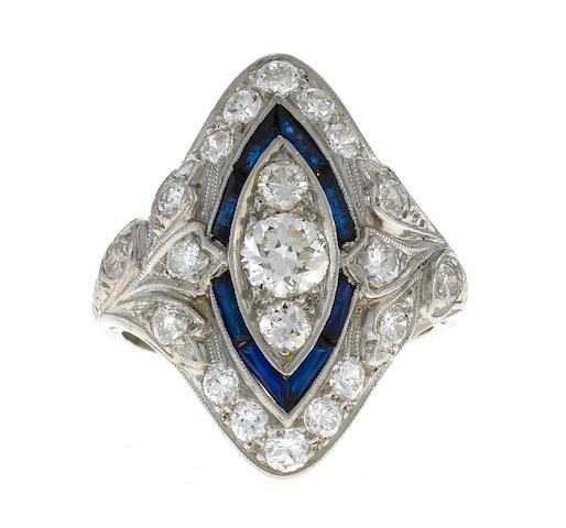 A diamond, sapphire, and platinum ring