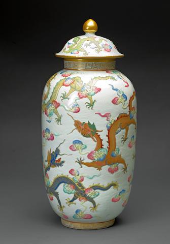 Famille rose enameled porcelain ovoid jar and cover