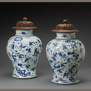 A pair of Chinese blue and white porcelain jars with 'one hundred children at play' motifs  Kangxi period