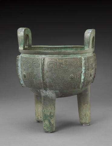 A cast bronze tripod vessel (ding) Shang dynasty