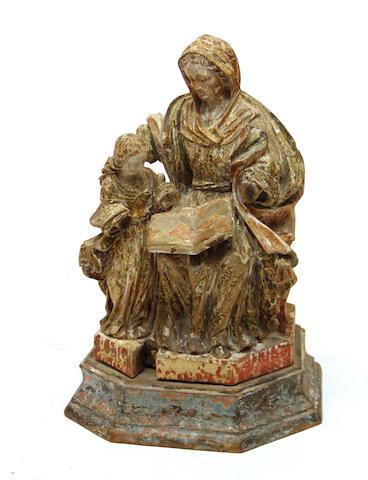 A Spanish Colonial carved and polychrome wood group: Education of the Virgin 18th century