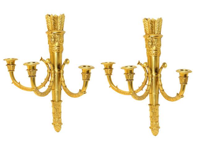 A pair of Louis XVI style gilt bronze three light bras de lumière 19th century