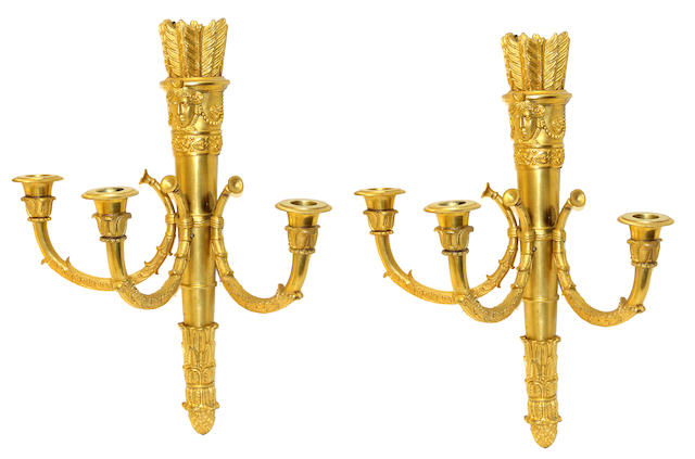 A pair of Louis XVI style gilt bronze three light bras de lumière 19th century