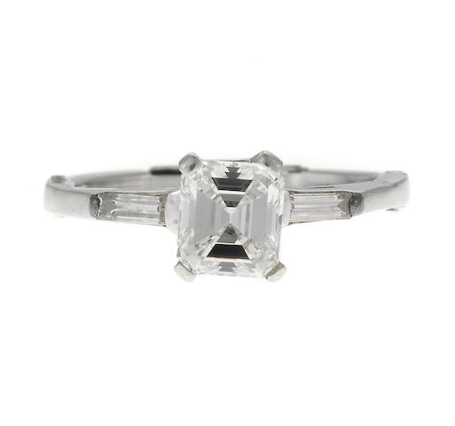 An emerald-cut diamond and white gold ring, diamond weighing 1.05cts.