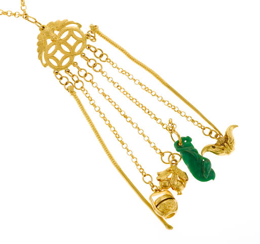 A jade and high karat gold (22k?) 6 piece chateleine, 72.6g (ear cleaner, toothpick, jade and 3 charms)