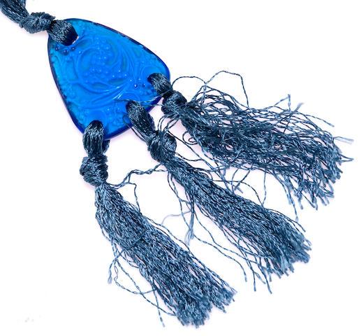 """A blue molded glass """"Graines"""" pendant/necklace, René Lalique,"""