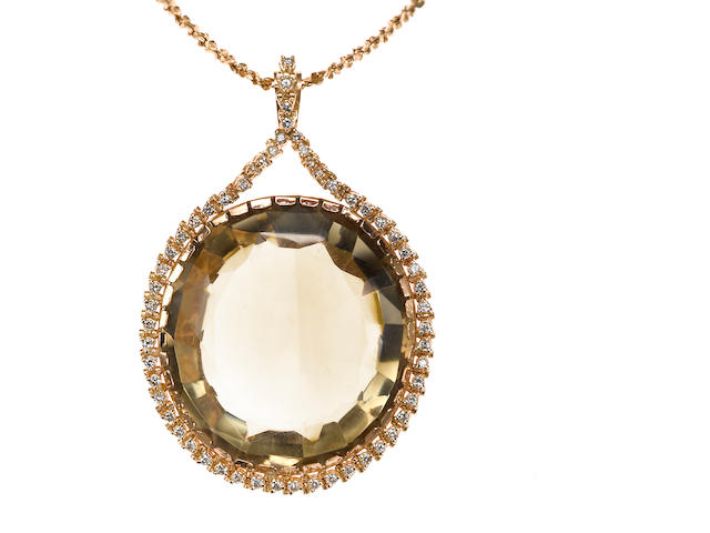 A smokey quartz and diamond pendant with chain