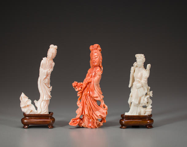 three carved coral figures