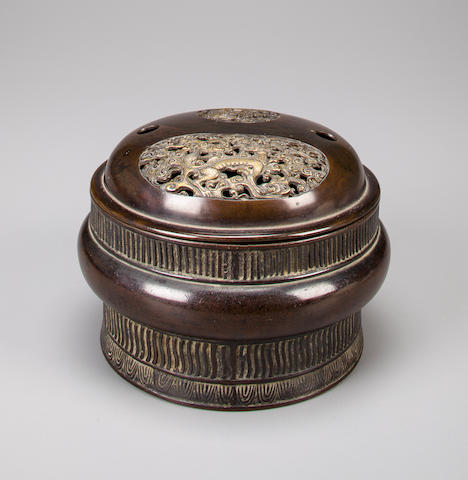 A bronze handwarmer with gilt decoration 18th/19th century