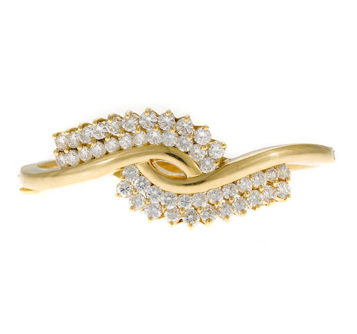 A gold and diamond bangle bracelet