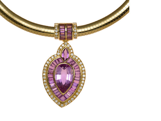 An amethyst and diamond pendant in 14k and 18k gold