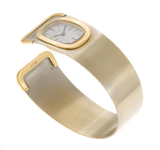 An eighteen karat bicolor gold bangle bracelet wristwatch, Tiffany & Co., French