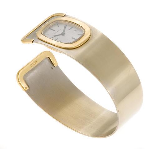 An eighteen karat bicolor gold bangle bracelet wristwatch, Tiffany & Co., French