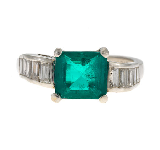 A diamond and synthetic emerald ring