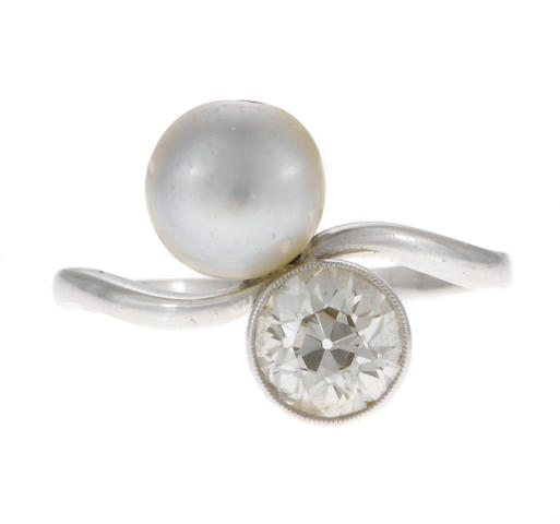 A diamond and cultured pearl bypass ring