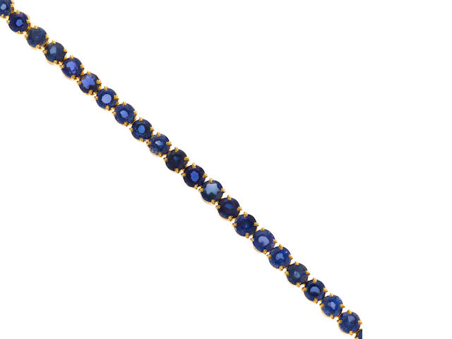 A synthetic sapphire and 18k gold line bracelet