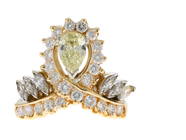 Fancy yellow and near colorless diamond ring in yellow gold with GIA cert
