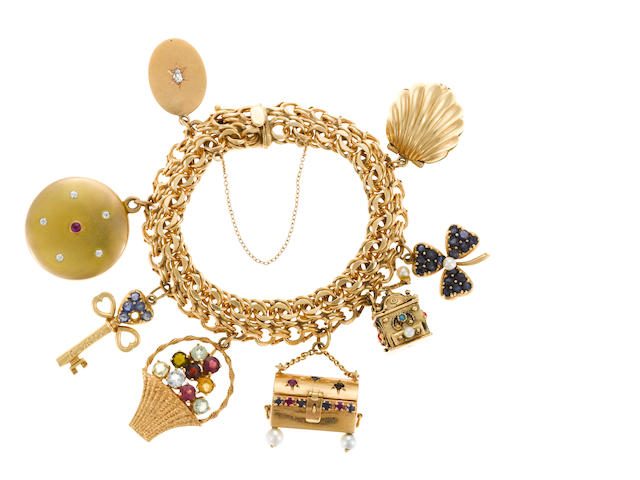 A gem-set and 14k gold charm bracelet (void one sapphire)