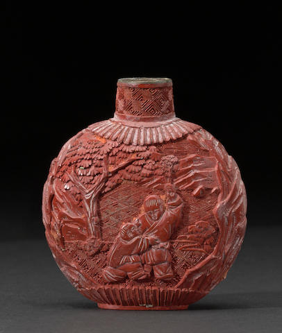 A carved cinnabar lacquer snuff bottle