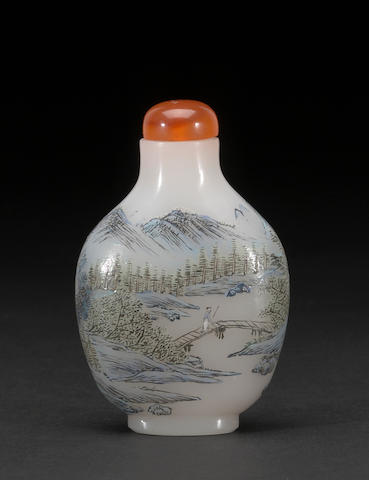 An enameled glass bottle