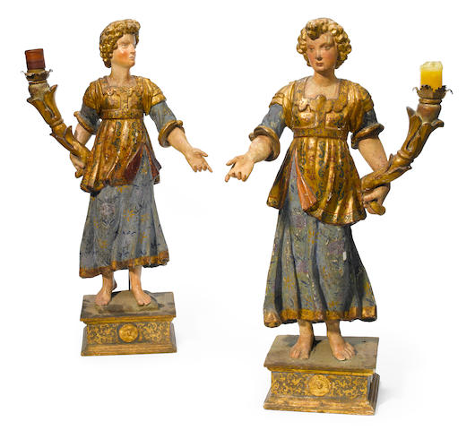 A pair of North European Baroque polychrome decorated figural candlesticks  probably German 18th century