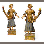 A pair of Continental Baroque style polychrome decorated figural torchères