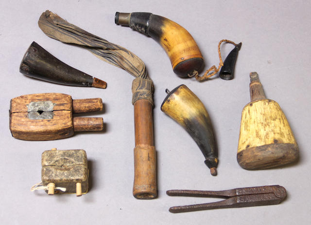 A lot of 18th and 19th century primer horns and bullet molds