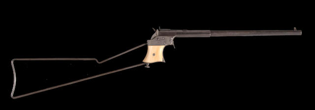 A long-barreled Remington Vest Pocket pistol with skeletal shoulder stock