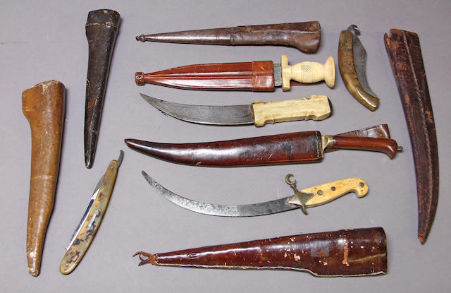 A group of edged weapons and scabbards